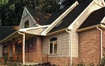 Дизайн отделки фасада дома камнем